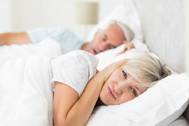 woman stopping snoring because of sleep apnea